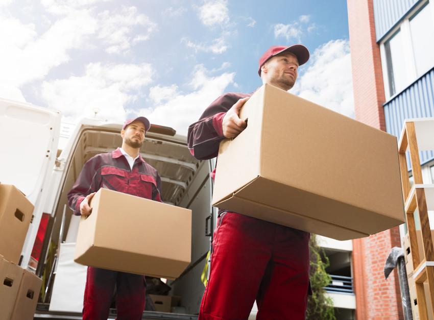 picture of two men unloading van